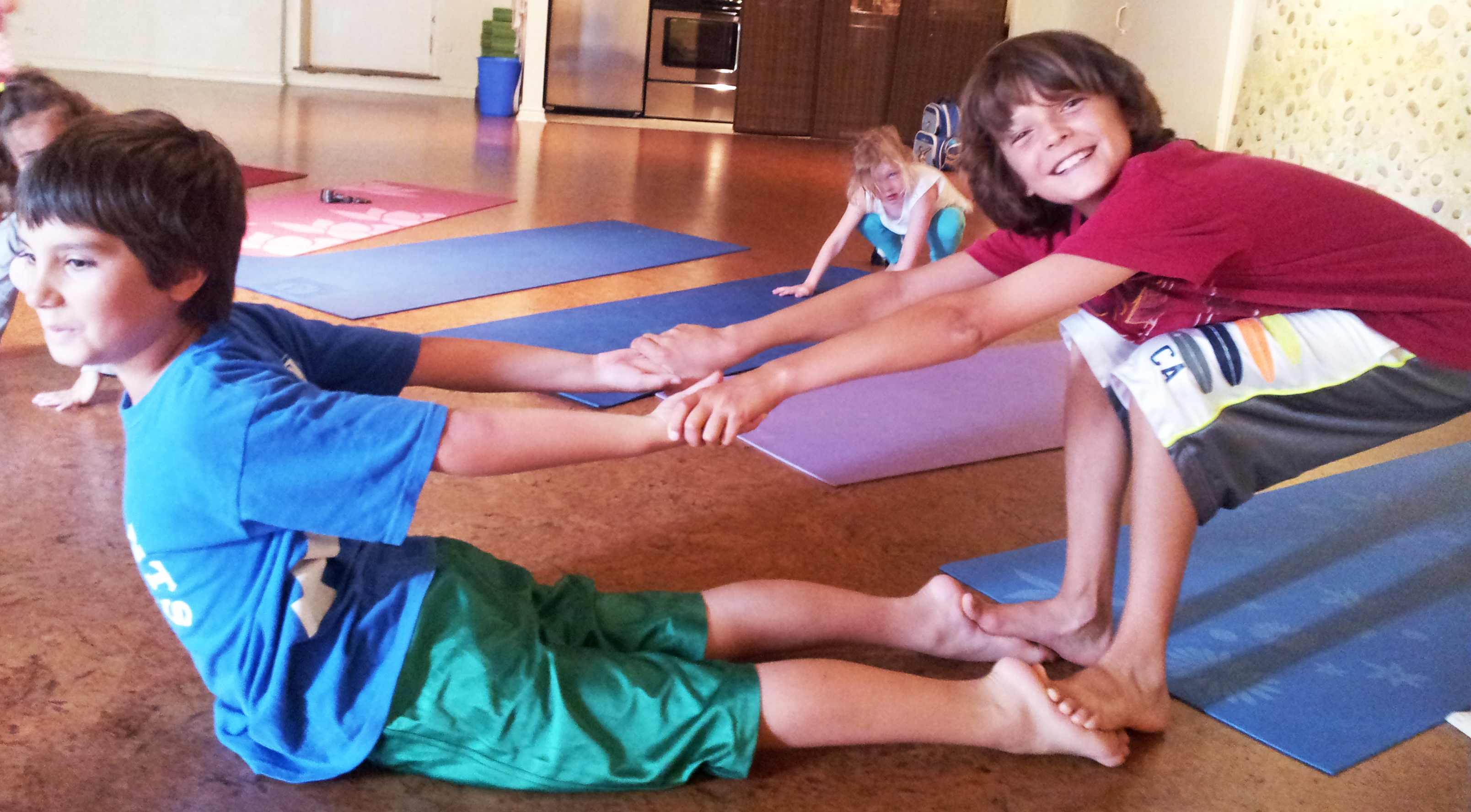 The Joys and Benefits of Teaching Kids Yoga